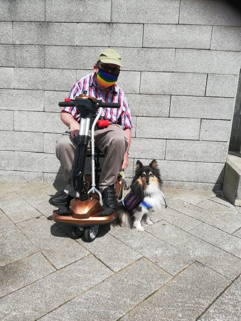 Member with thier fur baby just after passing thier public access assessment
