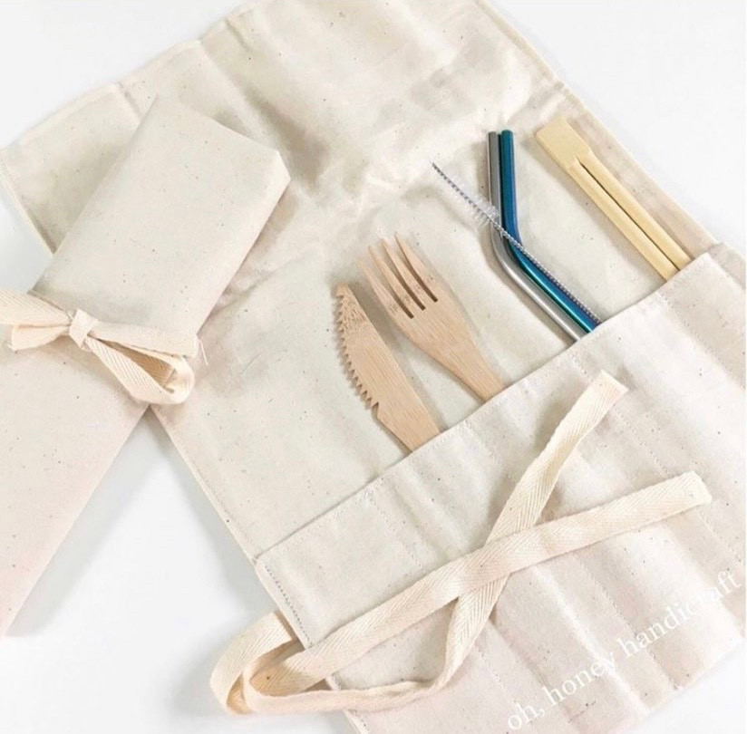 Utility Roll w/ bamboo cutlery set and metal straw and straw cleaner.