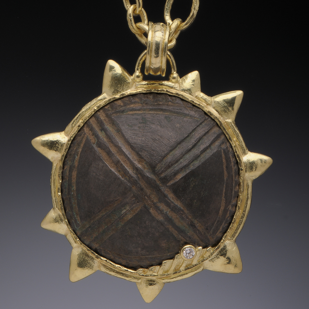 Bronze Button Amulet from a warrior's jacket set in 18K gold.  Chain is 18K small-medium.