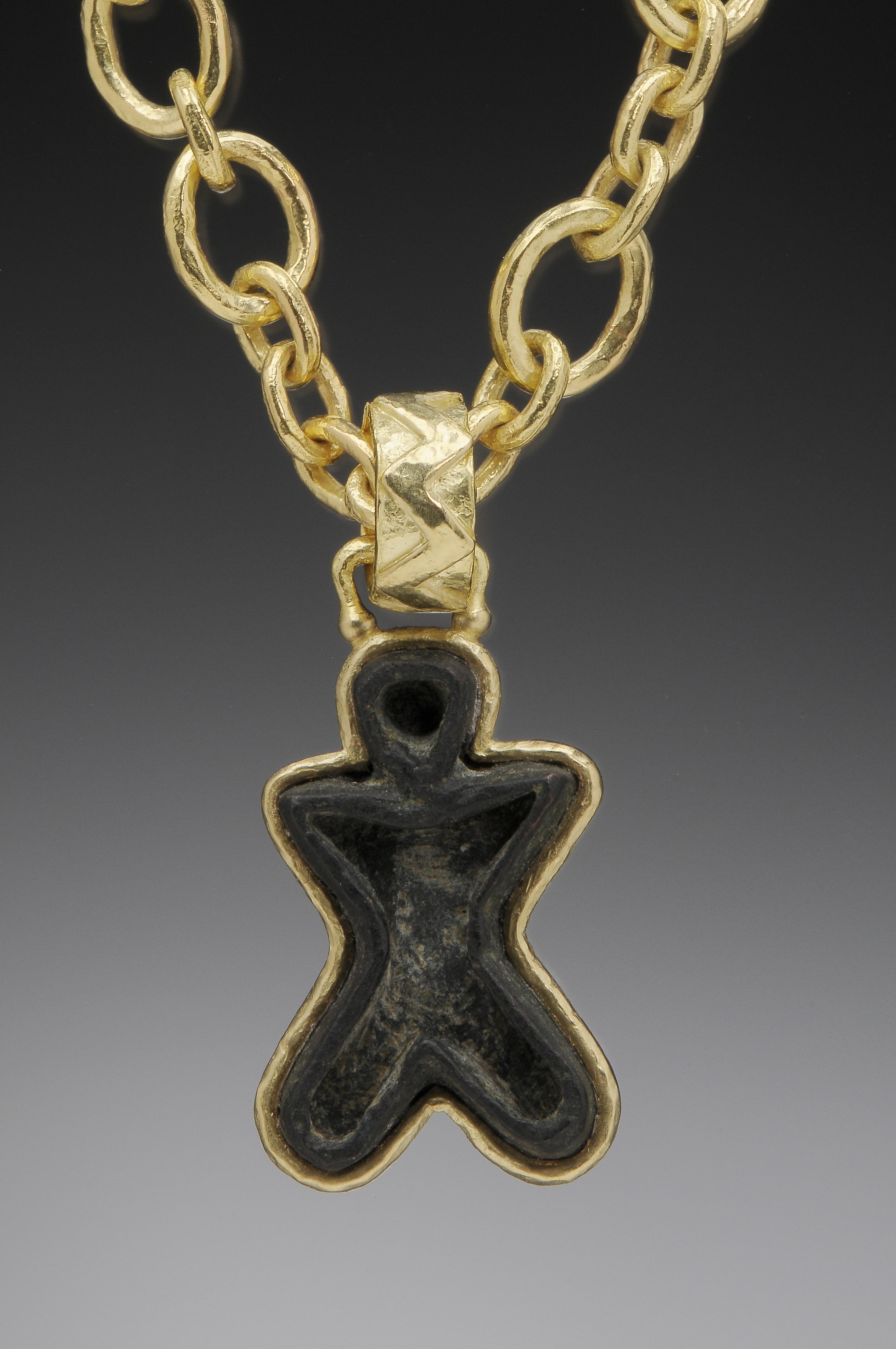 Front:  Bronze Man Seal Pendant