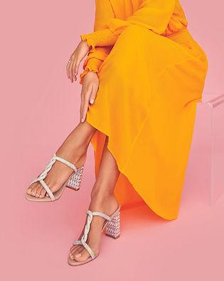 Model wearing cream strappy sandals - shoe feature.jpg