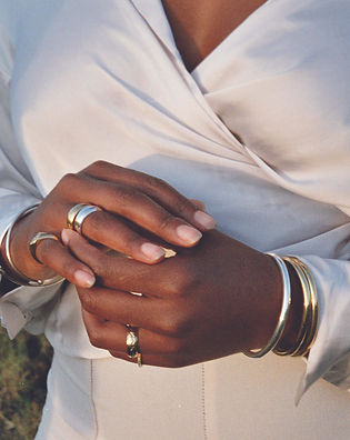 Gold rings and bangles on hands.jpg