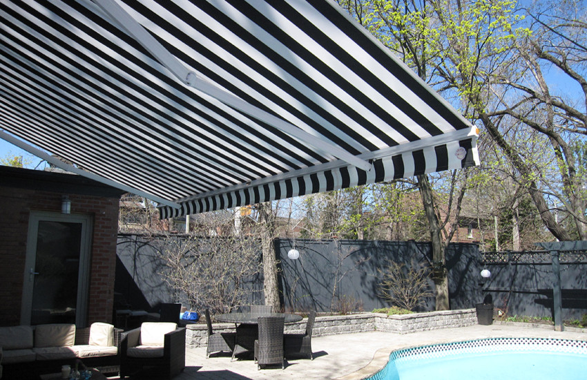 Awning by the pool of Victorian style ho