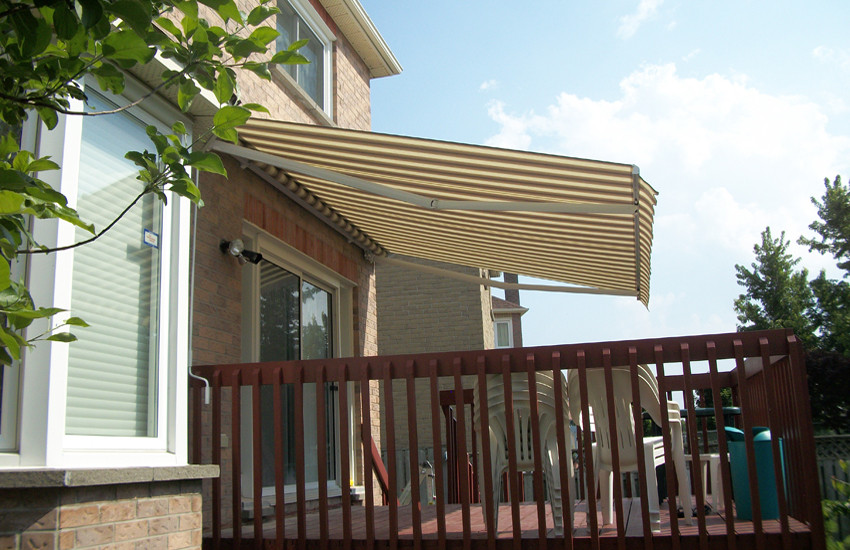 Cream awning over auburn deck.jpg