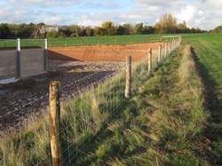 Stock fence. Chestnut posts