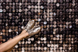 silver-wingtip-shoes-on-silver-backgroun