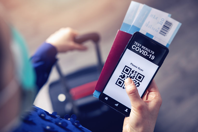 person in airport using mobile app in phone to show covid-19 test results for travel.jpg