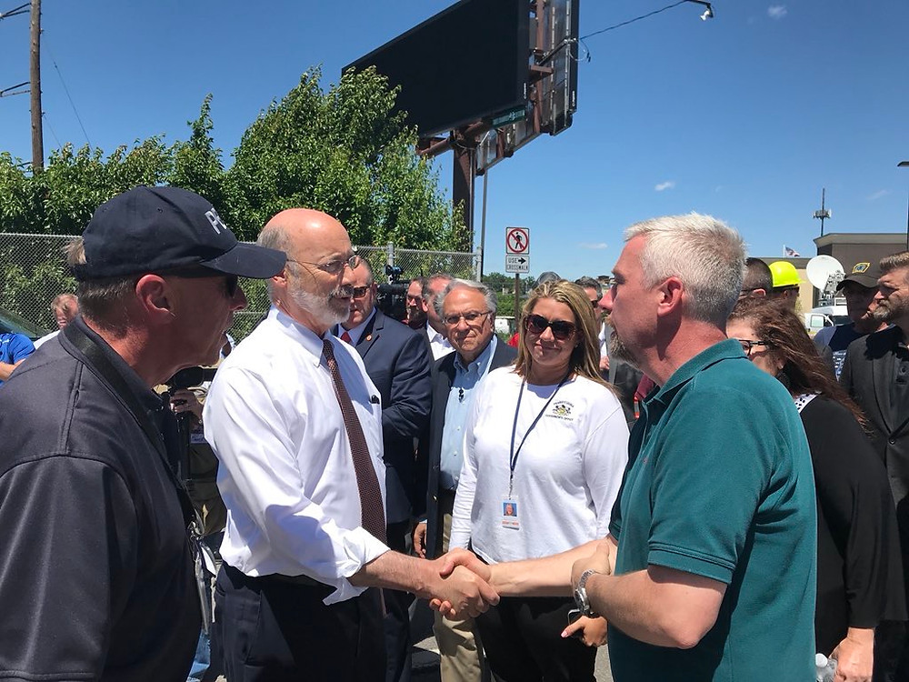 PA Governor Wolf visiting with storm damaged business owners & residents. (Photo by PEMA Director Rick Flinn)