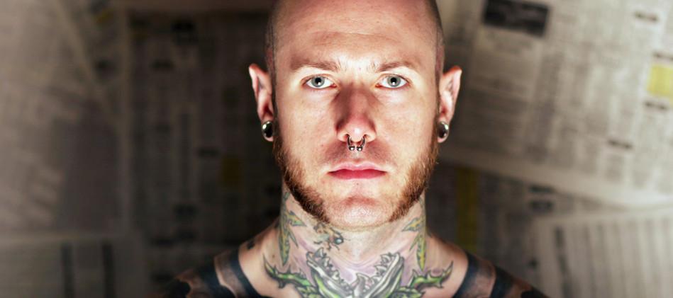 piercing tattoo man.jpg