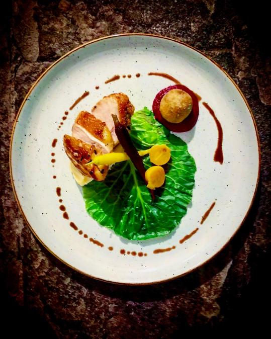 Roast guniea fowl breast, confit leg & tarragon bonbon, smoked butter pomme puree, seasonal vegetables & roasting juices
