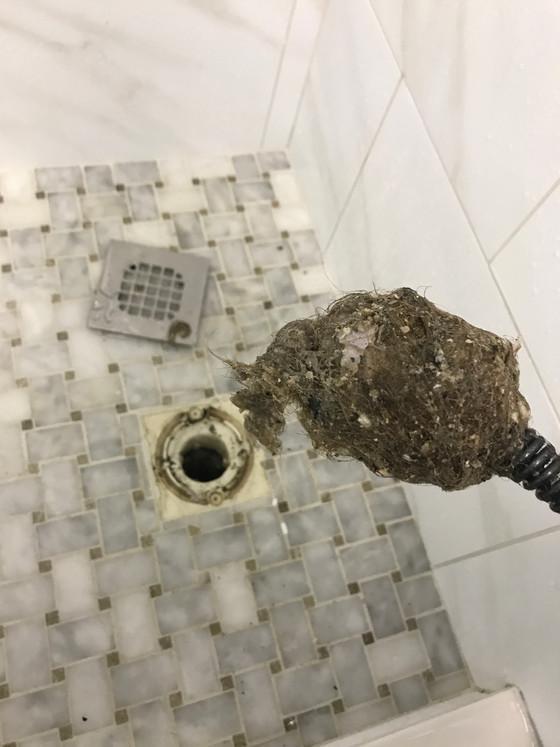 Shower or tub draining slowly?