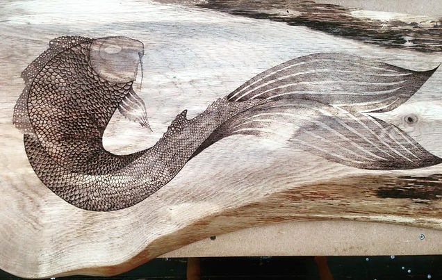 Fish on oak woodburned