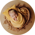 Baby girl sleeping at her newborn photoshoot in Newport