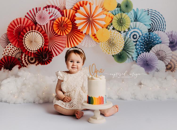 Birthday girl with rainbow