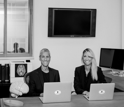 Stephanie and John Cacioppo at their desk at the University of Chicago