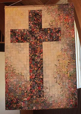 Quilted banner with a cross design.