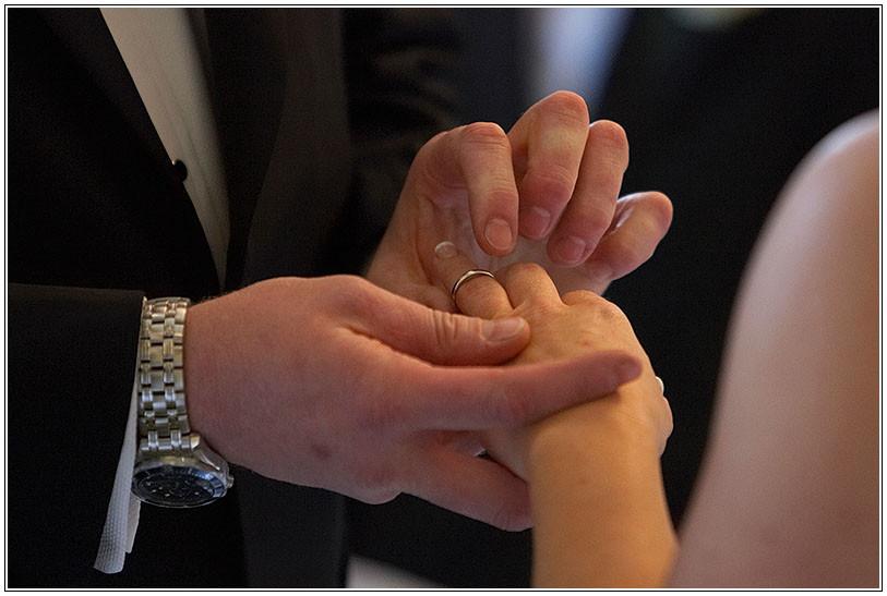 groom placing ring on brides finger.jpg