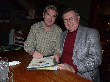 Kiltmaker, Ken MacDonald, and Apollo 12 Astronaut, Dick Gordon, sign the certificate for the first Apollo 12 Tartan Kilt owner