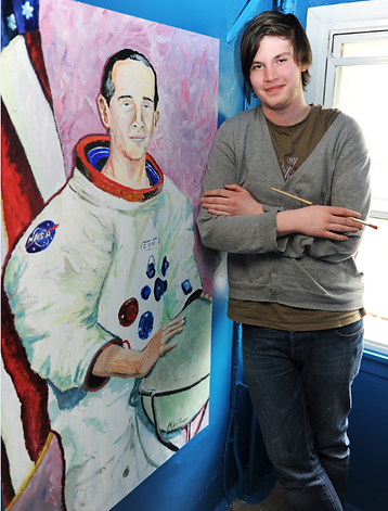 Artist Allister Gardener with his Portrait of Charlie Duke