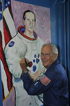 Charlie Duke signing his portrait when he visited the Observatory in 2010