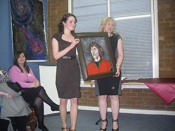 Artist, Anna, presenting her portrait of Copernicus to Aileen Malone