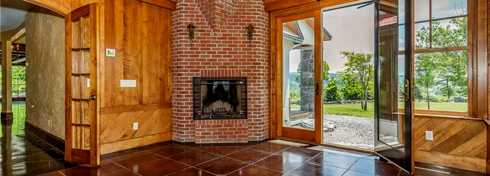 Bamerick Fireplace vaulted ceiling stained concrete floors.jpg