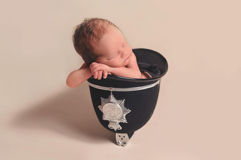 baby in police helmet.jpg