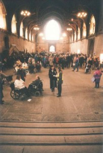 A large historic hall. It's nearly full with groups of people with varying disabilities.