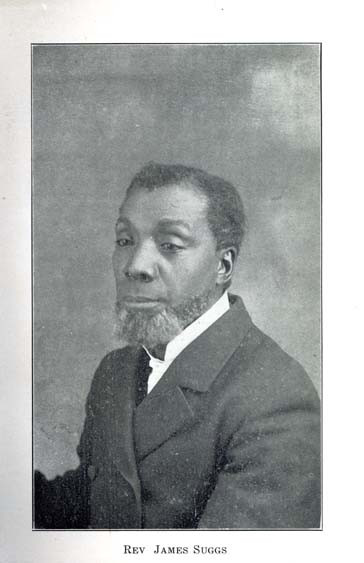 A black and white photograph of James Suggs, a black man with a beard but no mustache wearing a suit and tie