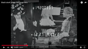 A woman playing the piano in the background, in the foreground a man looks terrified while looking at a ghostly figure of a eugenecist