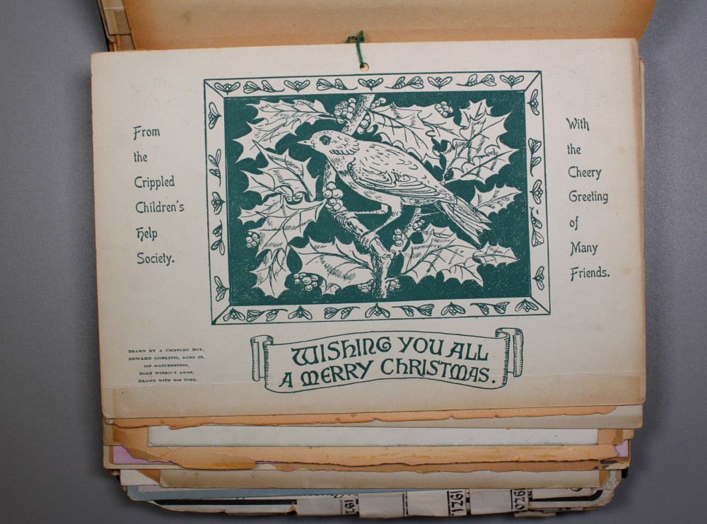 """A bird sits on a branch surrounded by holly. The wntire drawing is green and white. Writing reads """"From the Crippled Children's Help Society, with the cheery greeting of many friends."""