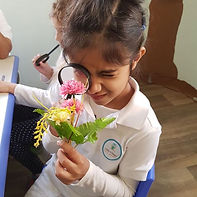 Amna exploring her flower 🌸