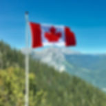 canada-flag-with-mountain-range-view-756