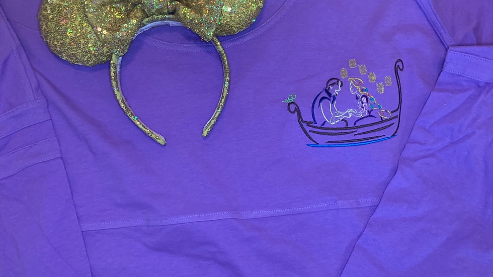 Rapunzel and Flynn in boat embroidered spirit jersey