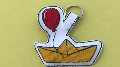 We all float down here embroidered keychain