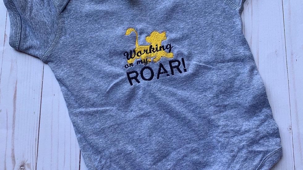 Working on my roar embroidered onesie