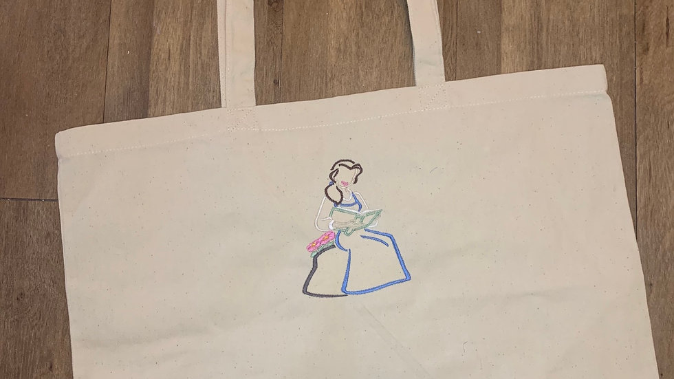 Belle with her Books Large Canvas tote