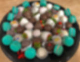 Party tray with macaroons, chocolate cov