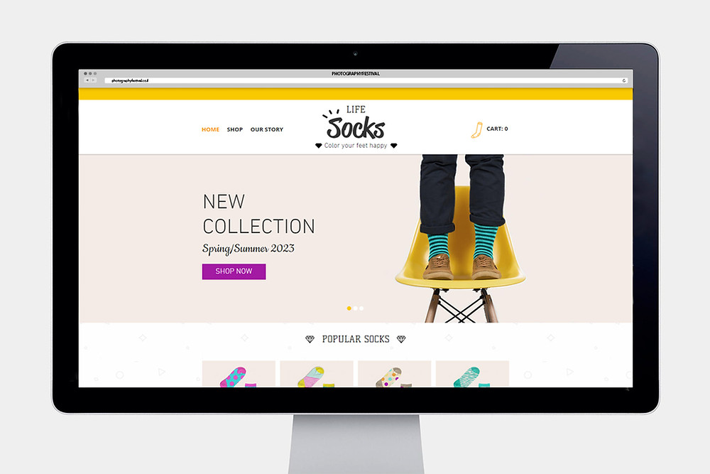 """Computer screen displaying a """"Socks"""" website home page"""