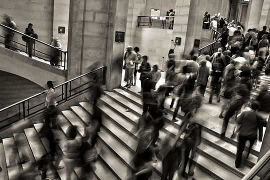 greyscale people in motion on stairs.jpg
