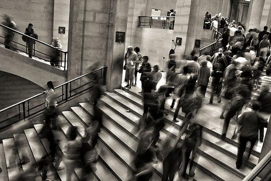greyscale people in motion on stairs.jpg