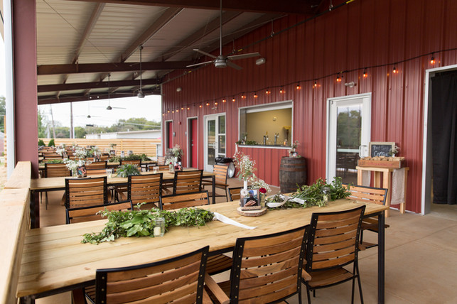 Outdoor patio space set up for a wedding reception.