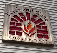 A picture of Earth & Stone's exterior sign featuring its logo.