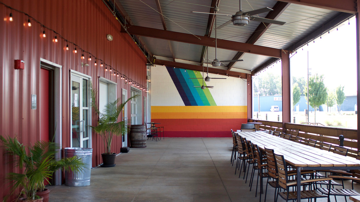 Covered patio with mural.