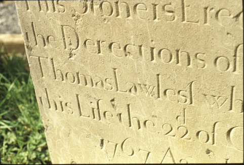 close-up of lettering on 18th-century headstone (T Lawless 1764).  5/5/88