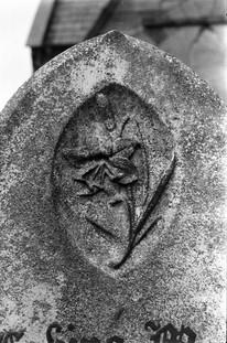 Detail of headstone: flowers