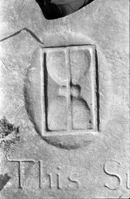 Detail of previous headstone: hourglass.