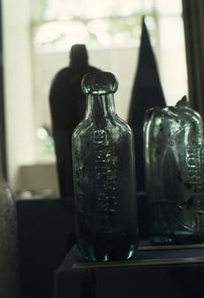 Exhibition: old medicine bottle (Hamilton Long).  5/5/88