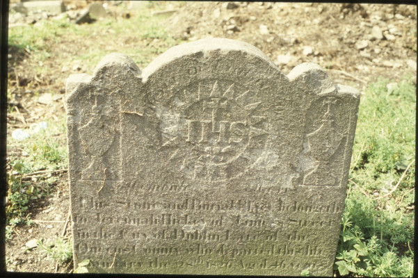 detail of headstone: HIS in sun.  5/5/88
