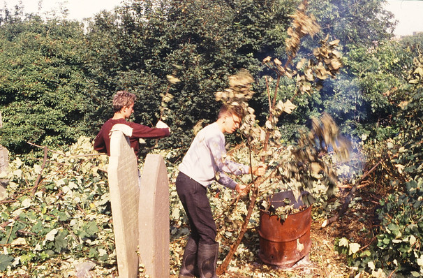 Trainees burning cut-down weeds and branches: Donald Stokes, George Cully. 18/9/87